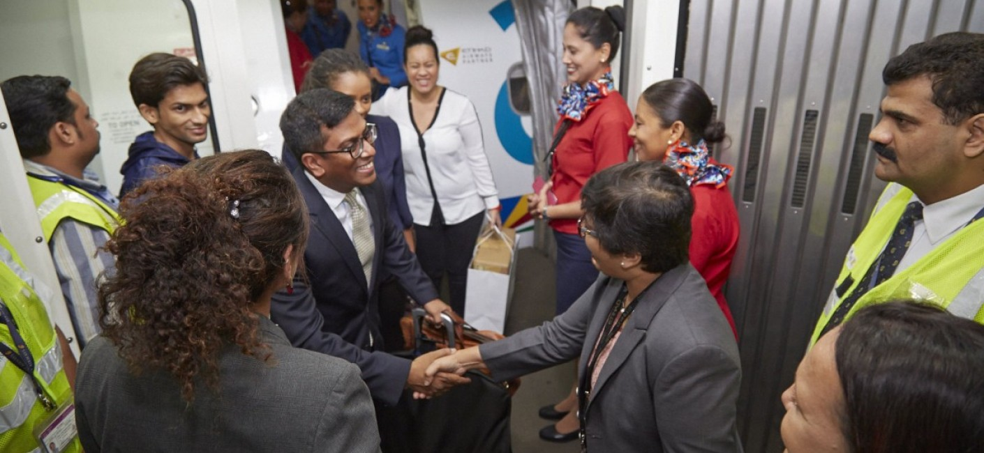 Manoj Papa, Air Seychelles' Chief Executive Officer, and Sherin Naiken, Chief Executive Officer of the Seychelles Tourism, are greeted by airport officials