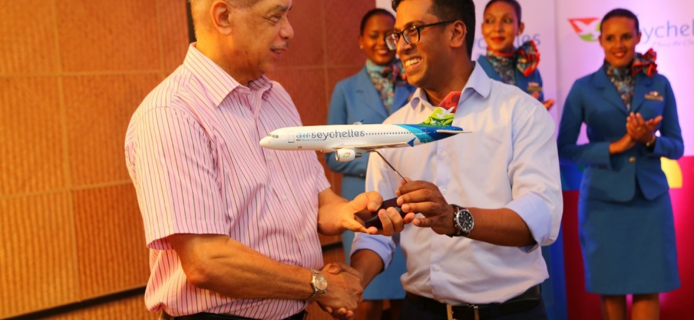 President Michel receives a model aircraft of 'Amirantes' from Air Seychelles' Chief Executive Officer, Manoj Papa