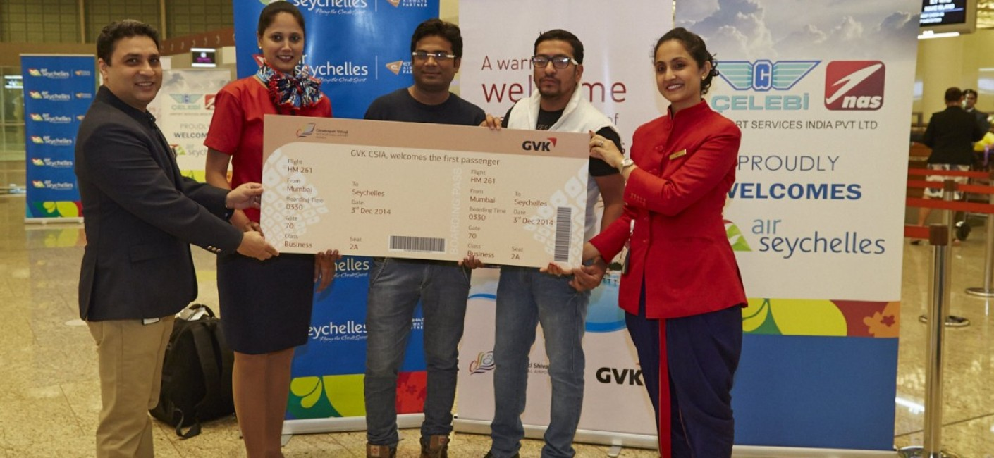Naveen Chawla, Vice President Aero Marketing at GVK, one of India's largest private sector airport operators, presents the first commercial passengers flying Mumbai – Mahé with a commemorative ticket